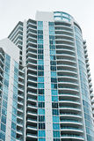 Luxury Condominium High Rise. Modern, luxury condominium high rise located in Miami Beach, Florida. Taken from low perspective upward royalty free stock photo