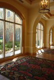 Luxury corridor. With oriental rugs and tall sweeping archways Royalty Free Stock Image