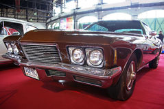 Luxury coupe Buick Riviera. BUDAPEST - APRIL 16: 315LE boattailed-roof Buick Riviera from 1971 in exclusive 'Deep Chestnut' color on 4th Oldtimer Expo on April Stock Photo