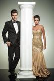 Luxury couple posing in studio near column Stock Photography