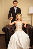 Luxury couple in rich interior Royalty Free Stock Images