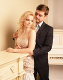 Luxury couple in rich interior Royalty Free Stock Photo