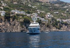 Luxury crewed motor yacht on the Amalfi Coast near Positano, Campania. Italy royalty free stock photos