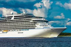 Luxury cruise liner in travel. Luxury cruise liner underway. Tour travel and spa services stock image