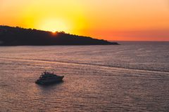 Luxury cruise ocean liner ship sailing from port on sunrise, sunset, Italy Sorrento bay, travel tour, work on the ship, vacancies stock photo
