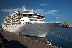 A luxury cruise ship. Docked in the port Royalty Free Stock Photo