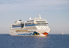 Luxury cruise ship. Sailing from port Royalty Free Stock Images