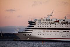 Luxury cruise ship. A picture of a luxury cruise ship, sailing in calm waters in the evening Stock Photography