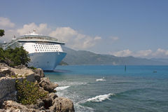 Luxury Cruise Ship Anchored Along Rocky Coast Royalty Free Stock Image