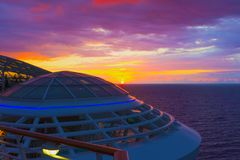 Luxury Cruise Ship Deck at Sunset. Luxury Cruise Ship Deck, sea, sky at sunset stock images