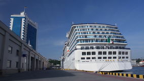 A luxury cruise ship docked in the port Stock Photo