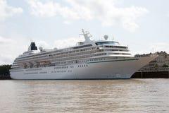Luxury cruise ship docked under blue cloudy sky Royalty Free Stock Image