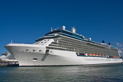 Luxury Cruise Ship Docked Under Blue Sky Royalty Free Stock Image