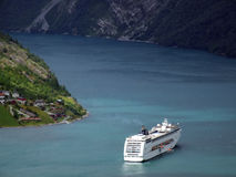 Luxury cruise ship in a fjord. Aerial view of a luxurious cruise holiday ship in Norway Stock Photo