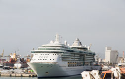 Luxury Cruise Ship in Industrial Port Stock Image