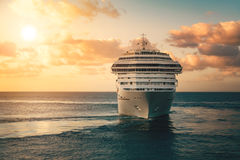 Luxury cruise ship. Leaving port at sunset Royalty Free Stock Images