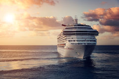 Luxury cruise ship. Leaving port at sunset Stock Photos