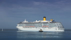 A luxury cruise ship leaving port with tugs assistance timelapse. Full HD stock footage