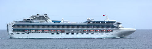 Luxury Cruise Ship Panorama. This is a panorama (lots of detail at 100%) of a luxury cruise ship in Cabo San Lucas, Mexico. 12MP camera. Focus = midship royalty free stock image