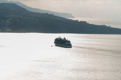 Luxury Cruise Ship Sailing far to the horizon in the bay, Sorrento Italy royalty free stock image
