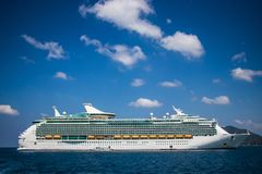 Luxury cruise ship sailing from port. Big cruise ship in the sea Royalty Free Stock Images