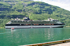 Luxury Cruise Ship Sailing from Port Norway mountains in the background Stock Photo