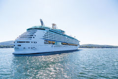 Luxury Cruise Ship in Sunny Bay Stock Photo