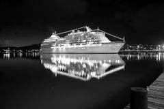 Luxury cruise ship at sunset. Glowing at the night Royalty Free Stock Photos