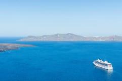 Luxury cruise ships, caldera and volcano near Fira, capital of the Greek Aegean island, Santorini, Greece. Panorama Royalty Free Stock Photos