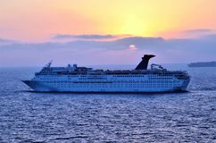 Luxury cruise vessel at sea during sunset. royalty free stock photo
