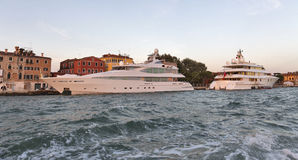 Luxury cruise yachts in Venice lagoon, Italy. Stock Photo