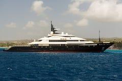 Luxury Cruiser in Barbados. As seen from a catamaran off the coastline of Barbados Stock Photos