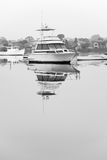 Luxury cruiser moored on still water Stock Image