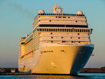 Luxury cruising ship ready to sail away. front angled view Royalty Free Stock Image
