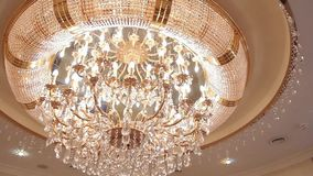 Luxury crystal chandelier on the ceiling stock video