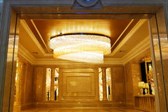 Luxury crystal chandelier lighting. In a hotel hall Stock Photo