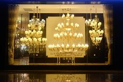 Luxury Crystal chandelier lighting in shop window. Luxury Crystal chandeliers in the shop window at night royalty free stock photos