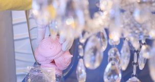 Luxury crystals of a classic chandelier.Close up beautiful crystals of a luxury chandelier. bowl of marshmallows stock footage
