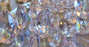 Luxury crystals of a classic chandelier.Close up beautiful crystals of a luxury chandelier. Candy bar background stock video