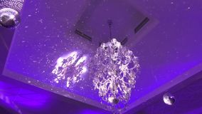 Luxury crystals of a classic chandelier. In a restaurant stock footage