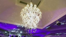 Luxury crystals of a classic chandelier. In a restaurant stock video