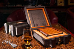 Luxury Cuban cigars in a box and alcohol Stock Photography