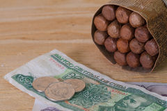 Luxury Cuban cigars and money on the wooden desk Stock Image