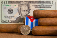 Luxury Cuban cigars with US dollar banknote and coin Royalty Free Stock Image