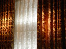 Luxury curtain. In the window Royalty Free Stock Photos