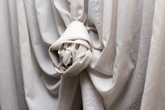 Luxury curtain with decorative knot. Beautiful curtain with decorative knot on window stock photos