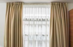 Luxury curtain at window in house. Close up luxury curtain at window in house stock photos