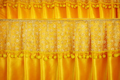 Luxury curtains with gold peach lace sits Royalty Free Stock Photos