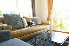 Cushion on brown leather sofa in living room. Luxury cushion on brown leather sofa in modern living room royalty free stock photos