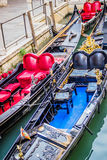 Luxury decorated gondolas on water canal in Venice, Italy Royalty Free Stock Photos
